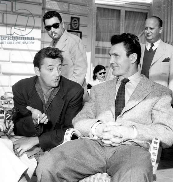 Jack Palance and Robert Mitchum at Cannes Film Festival March 30, 1954 (b/w photo)
