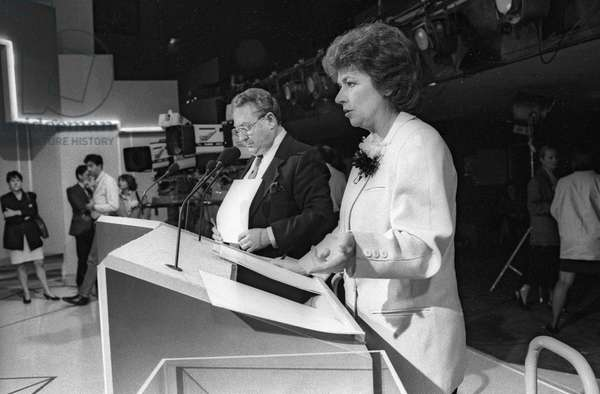 French journalists Gerard Carreyrou and Michele Cotta at time of a debate between candidates at the european election (TF1), Paris, June 9, 1989 (b/w photo)
