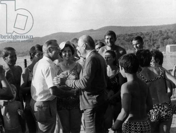 during his Holiday in Fort De Bregancon (South of France), French President Georges Pompidou With Bathers at The Beach in Cabasson August 7, 1972 (b/w photo)