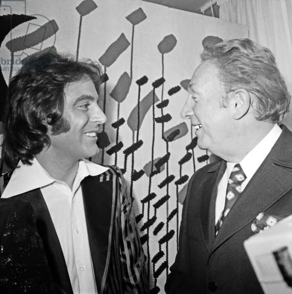 Charles Trenet congratulating Michel Delpech after his premiere at the Olympia, Paris, March 31st 1972 (b/w photo)