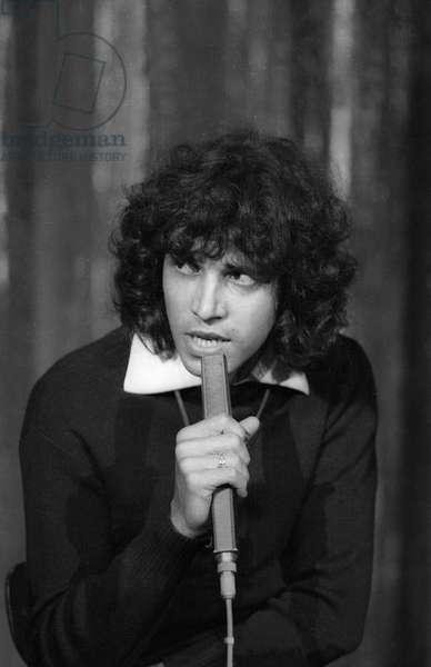 French singer Julien Clerc singing on the 'Bouvard en Liberte' TV programme in Paris, on May 9, 1975