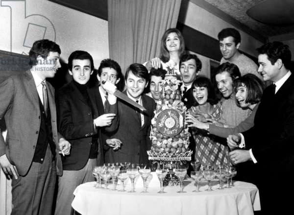 French Singer Monty (Knife) Celebrating his Birthday on February 17, 1965 in Presence of Lucky Blondo, Dick Rivers, Romuald, Dalida, Hubert, Chantal Goya, Franck Alamo, Daniel Gerard, Eileen and Claude Ciari (b/w photo)