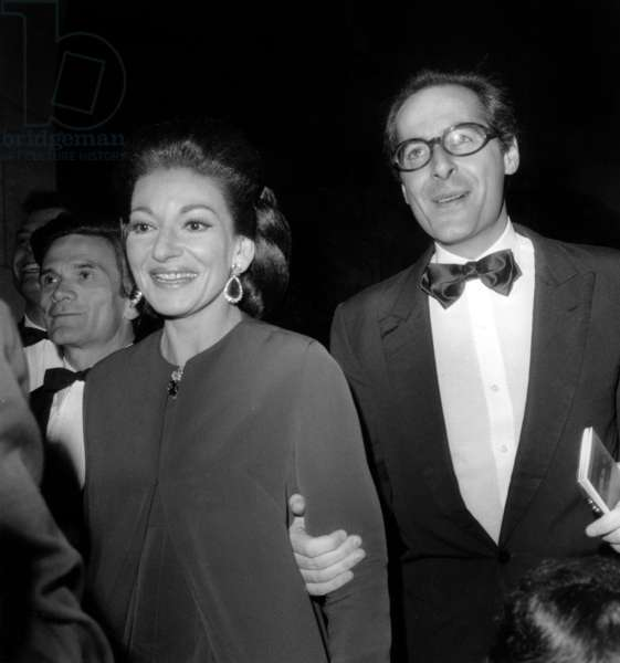 Soprano Maria Callas With Producer Franco Rossellini (And Behind Pier Paolo Pasolini) Arriving at Paris Opera House For Gala of Film Medea January 29, 1970 (b/w photo)
