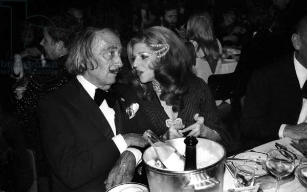 Salvador Dali and Baronness Marie-Helene of Rothschild at Premiere of Cabaret Revue Lido, Paris, December 13, 1973 (b/w photo)