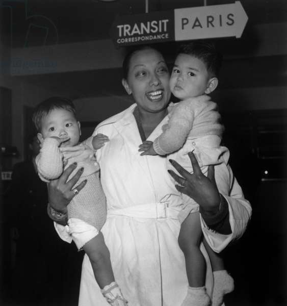 Josephine Baker in Orly Airport in Paris Coming Back From Japan With 2 Orphans May 12, 1954 (b/w photo)