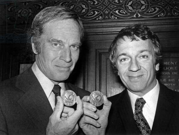 Charlton Heston and Jean-Pierre Cassel With Medal of Paris They Have Just Received December 14, 1973 (b/w photo)