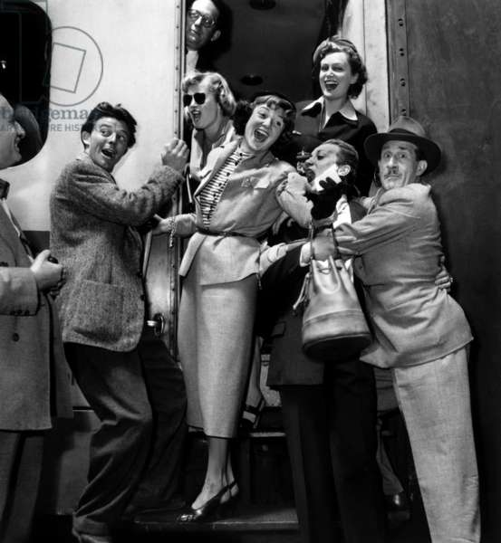 Gerard Philipe, Noel Rocquevert, Jacques Dacquine, Claude Farell, French Actress Sophie Desmarets (1922-2012), Blanchette Brynoy, Maurice Schuman on Departure For Brussels Festival. July 2Nd, 1949. (b/w photo)