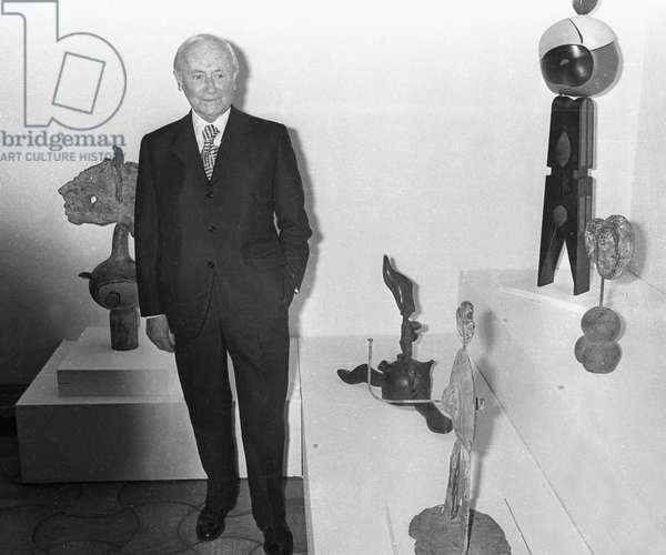 Joan Miro posing with some of his sculptures at the Maeght Foundation in Saint Paul de Vence during his work exhibition on April 17, 1973