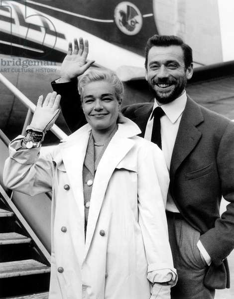 Simone Signoret and Yves Montand on July 23, 1956 at Orly Airport Leaving For Berlin For Filming The Witches of Salem  (b/w photo)