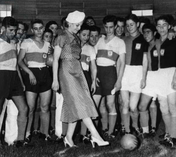 Eva Peron Kicking-Off Match of Soccer School Tournament in Buenos Aires January 26, 1951 (b/w photo)