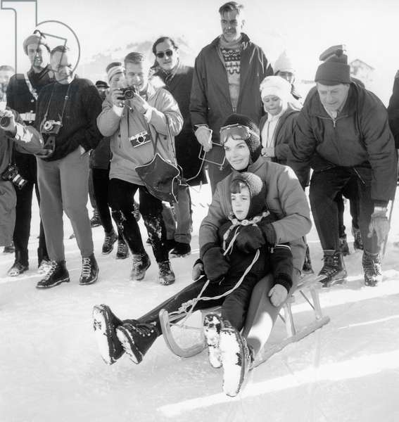 Jackie Kennedy and her son John Fitzgerald Kennedy Jr  during holiday in Gstaad (Switzerland)  going tobogganing, january 17, 1966 (photo)