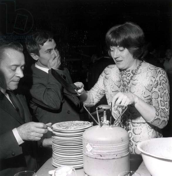 "Louis Daquin and Colette Renard Cooking Pancakes at Candlemas February 03, 1966 during Rehearsal of Play ""Jehanne Verite"", Paris (b/w photo)"