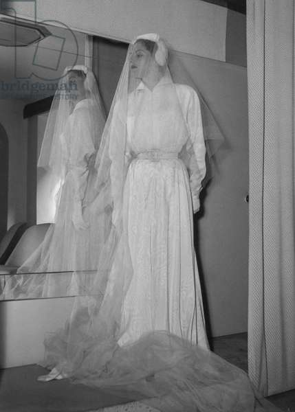 Wedding gown by Jean Bader, Paris, September 1949 (the wedding gown is in fact a travel suit) (b/w photo)