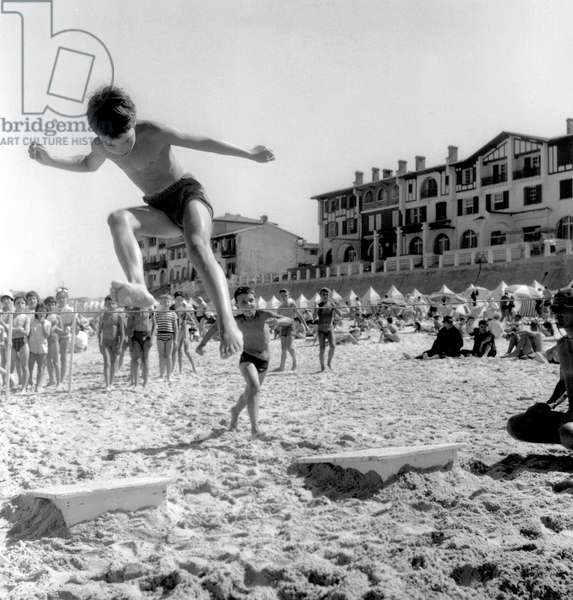 Entertainment on The Beach in Hossegor, France on August 9, 1960 (b/w photo)