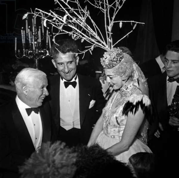 "Charlie Chaplin And Paul Louis Weiller Coming To See More Near The Baroness Of Cabrol's Set Who Embored ""Snow"" In ""Winter Ball"" At Ice Palace Or ""People of the World"" Giving Their Gala To Benefit From ""The Rising"" Child Assistance Work Abandoned December 8, 1954 Neg: A306 (b/w photo)"