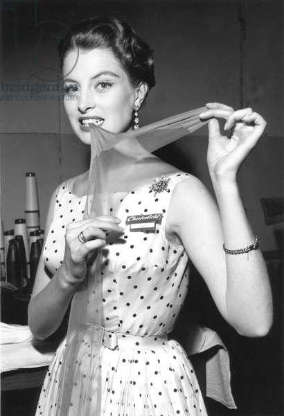French Model Capucine Presenting Nylon Stockings March 26, 1953 (b/w photo)
