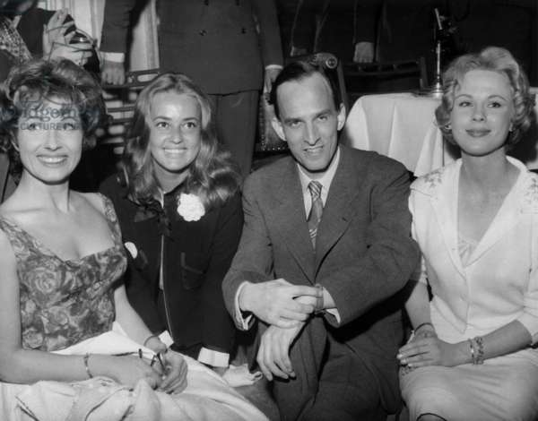 Ingmar Bergman Swedish Director during A Cocktail in A Parisian Salon on April 22, 1959 With Gunnel Lindblon Jeanne Moreau Bibi Anderson (b/w photo)