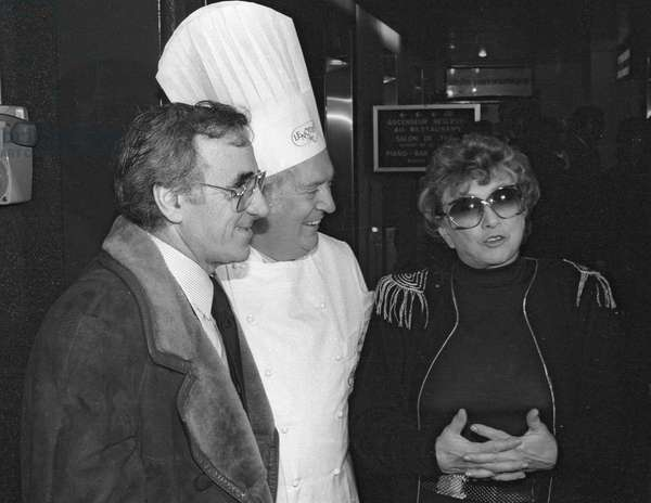 Mick Micheyl, french singer and steel sculptor, celebrating her career with Charles Aznavour and french confectioner Gaston Lenotre, Paris, January 1984 (b/w photo)