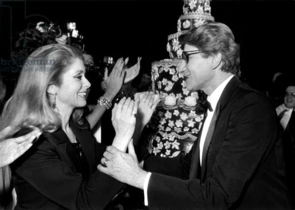 Yves Saint-Laurent Celebrating in Lido in Paris 20 Years of Haute Couture With Catherine Deneuve January 29, 1982 (b/w photo)