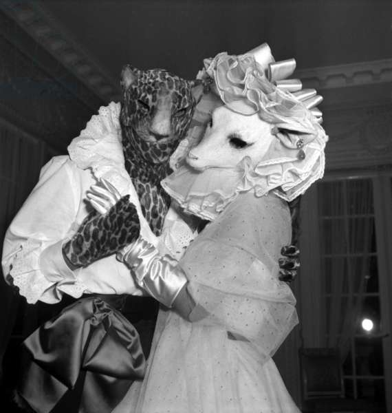 French Dress Designer Jacques Fath (With Head of Leopard) Dancing With his Wife Genevieve Boucher De La Bruyere during A Fancy Dress Ball on March 24, 1949 (b/w photo)