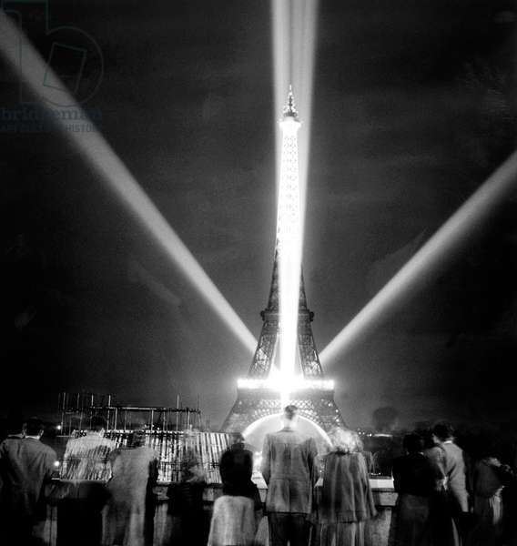 Eiffel Tower in Paris By Night during Test of Illumination, June 28, 1950 (b/w photo)