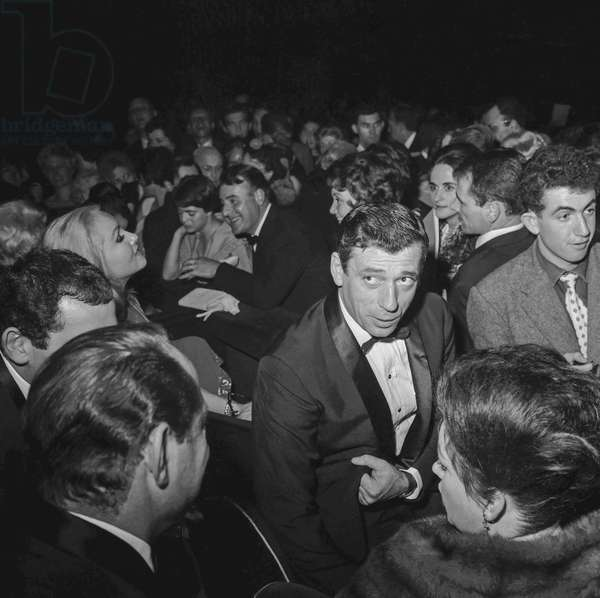 """French actor Yves Montand at premiere of film """"Let's make love"""" in Paris on October 4, 1960"""