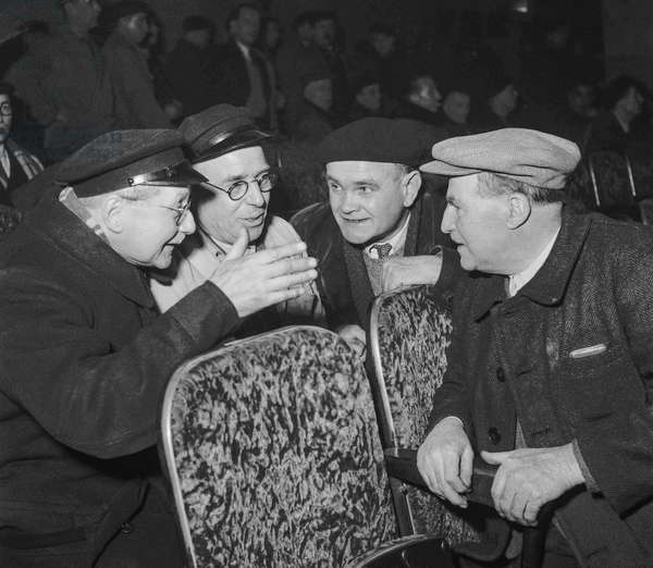 Meeting of taxi drivers at the Palais de la Mutualite in Paris on November 7, 1950 (speaking about the rise of the fees) (b/w photo)