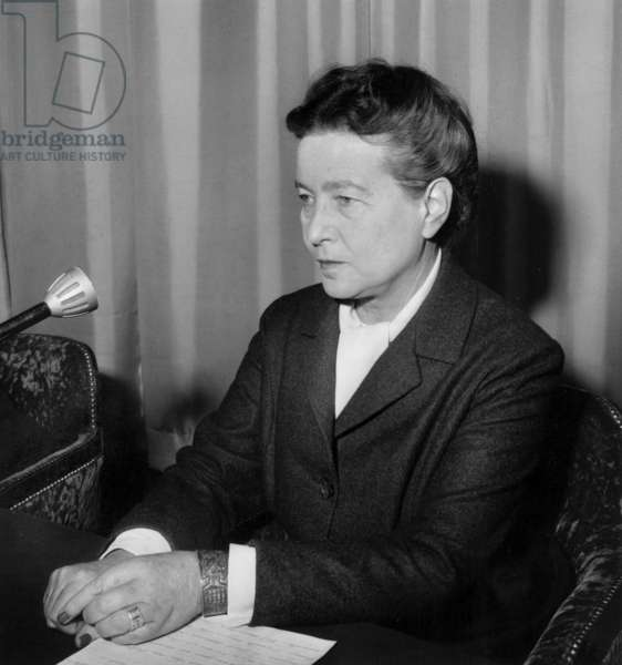 French Writer Simone De Beauvoir during Student Meeting in Paris December 10, 1964 (b/w photo)