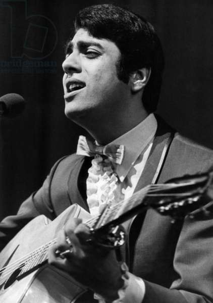 The Singer Enrico Macias Singing at The Premiere of his Show in Paris, March 8, 1968 (b/w photo)