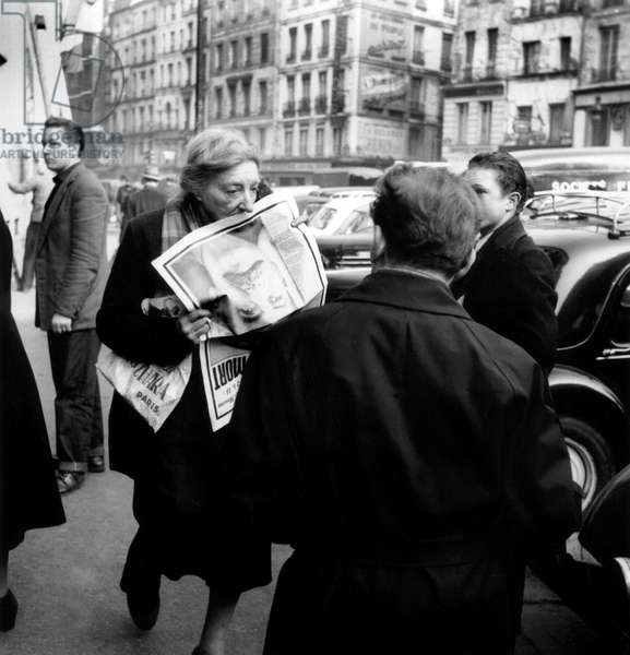 Woman Shattered By The Death of Stalin Announced in The Newspapers in Paris March 6, 1953 (b/w photo)