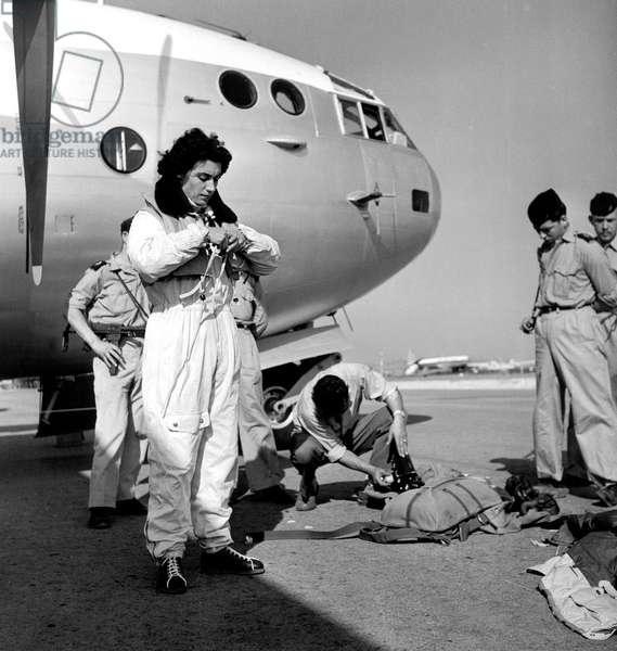 Colette Duval Preparing her Equipment Before Parachute Jump August 29, 1955  (b/w photo)