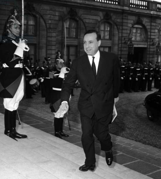 French Prime Minister Michel Debre Arriving at Elysee Palace in Paris To Attend Meeting of Franco-African Community. March 2, 1959. (b/w photo)