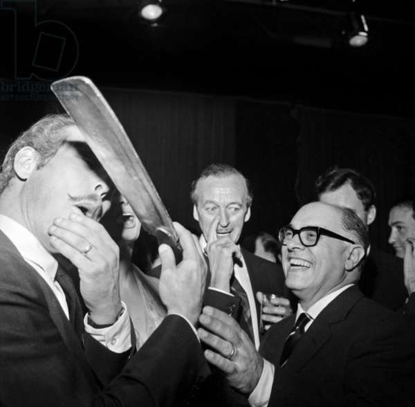Salvador Dali, David Niven and Carlo Ponti during A Cocktail For Actors of Film La Maison De Lady L, Paris, November 24, 1964 (b/w photo)