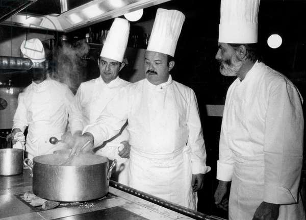 French Chef Cook Paul Bocuse With Mathias Thery and Jean and Pierre Troisgros here in The Kitchen at Elysee Palace February 25, 1975 (b/w photo)
