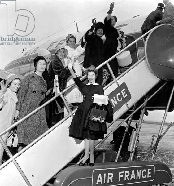 Young Actress Nadine Tallier Future Nadine De Rothschild Wearing Black Dress at Paris Airport With Models in Departure For Helsinki To Present New Parisian Fashion Collection at Fair in Finland October 9, 1958 Mode (b/w photo)