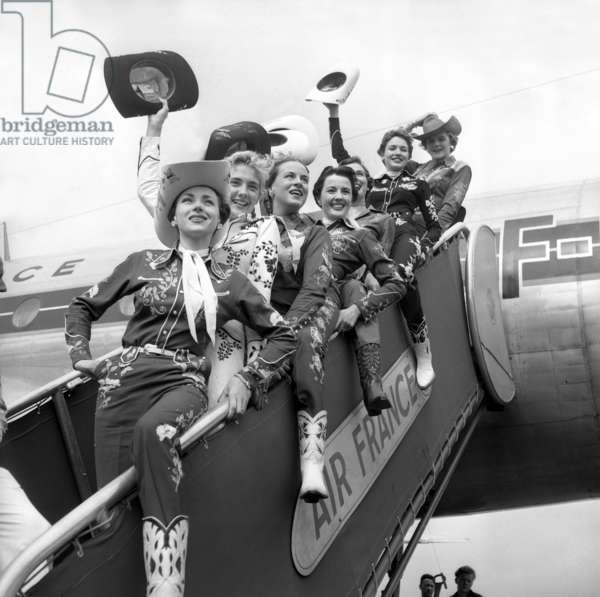 Models From Texas, With Cow Girl Suit, Arriving at Orly Paris Airport on July 9, 1952 (b/w photo)