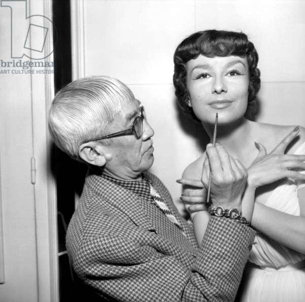 Painter Foujita Making Danielle Up in Harriet Hubbard Ayer Salon, Paris, June 10, 1952 (b/w photo)