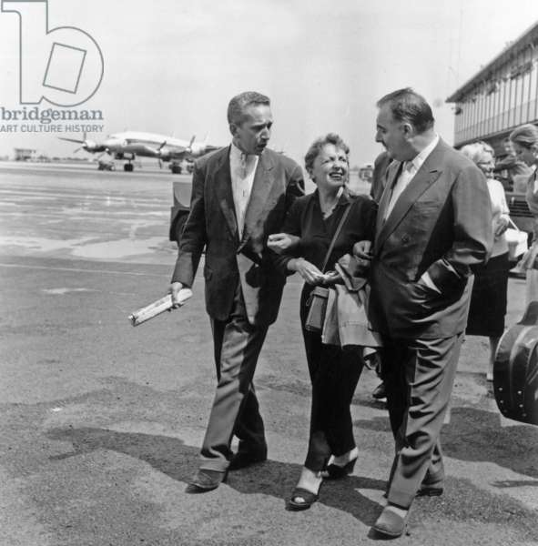 Edith Piaf Welcome By Marcel Blistene and Bruno Coquatrix at Orly Airport in Paris, August 8, 1957 (b/w photo)