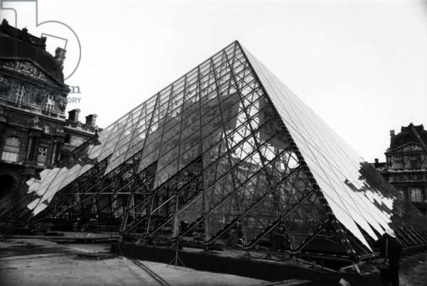 The Pyramid Du Louvre (Architect: Ieoh Ming Pei) whose installation of 666 windows is almost complete. Glass Panels Made of Two Glass Plates 10 mm Thickness Each, February 12, 1988. (b/w photo)