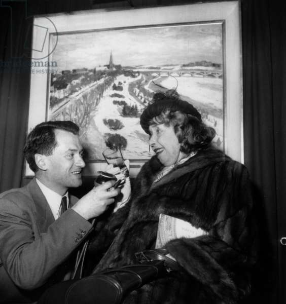 "Georges Decaunes and Mistinguett during Painting Exhibition ""Cities of Canada"" December 07, 1953 (b/w photo)"