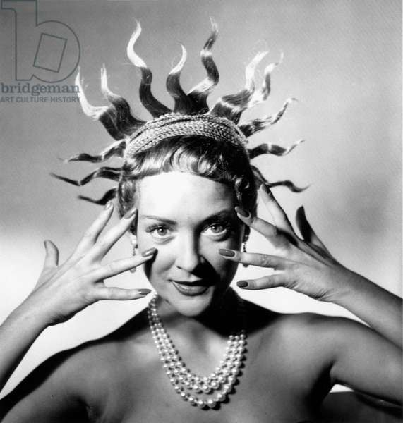 The model Praline with a Jean Clement's hairstyle at Woman and Beauty show in Paris, 6th October 1951 (b/w photo)