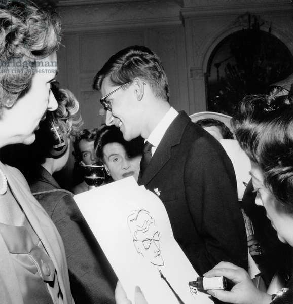 Dress Designer Yves Saint Laurent Congratulated After The Show of Dior Winter Collection on July 31, 1958 (b/w photo)