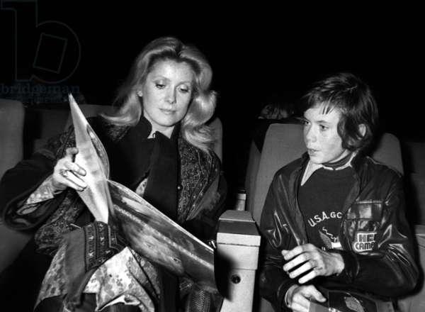 Catherine Deneuve and her Son Christian at Premiere of Robertcharlebois' Concert in Paris November 29, 1976 (b/w photo)