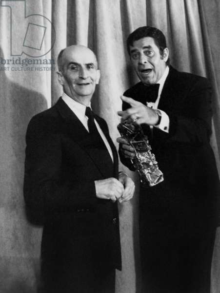 Jerry Lewis Gives A Cesar To Louis De Funes on February 4, 1980 (b/w photo)