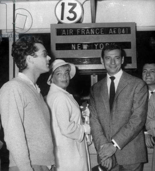 Yves Montand and his Wife Simone Signoret With Michel Legrand (L) at Orly Airport in Paris To Go in Unites States on September 10, 1959 (b/w photo)