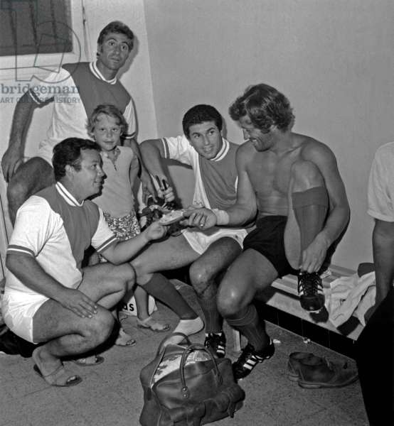 Claude Lelouch (On Bench on L) With Jean-Paul Belmondo in Cloakroom Before Football Match August 18, 1969 (b/w photo)