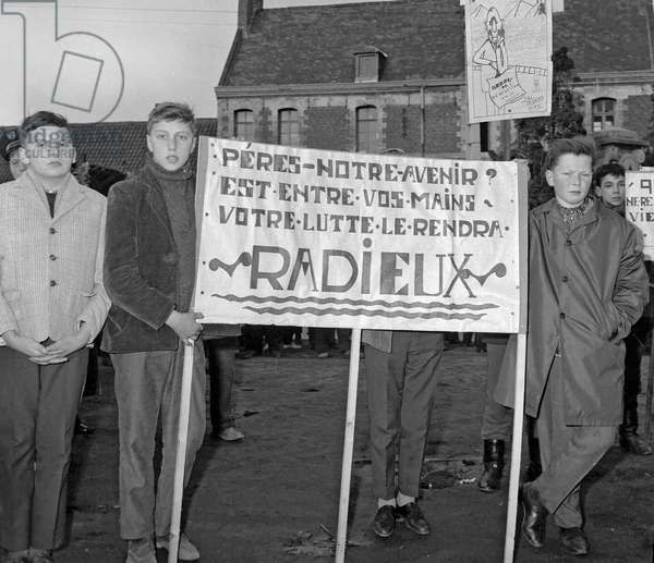 Miners on strike in France, March 15, 1963 : sons of miners supporting their fathers on strike, in Douai (b/w photo)