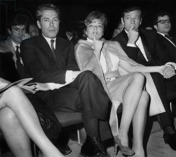 Professor Jacques Monod (Nobel Prize in Medicine), Simone Signoret, Yves Montand listen to Pastor Martin Luther King on the Podium of the Palais des Sports, during a Gala to Benefit the Struggle for Civil Rights in the USA. March 29, 1966 (b/w photo)