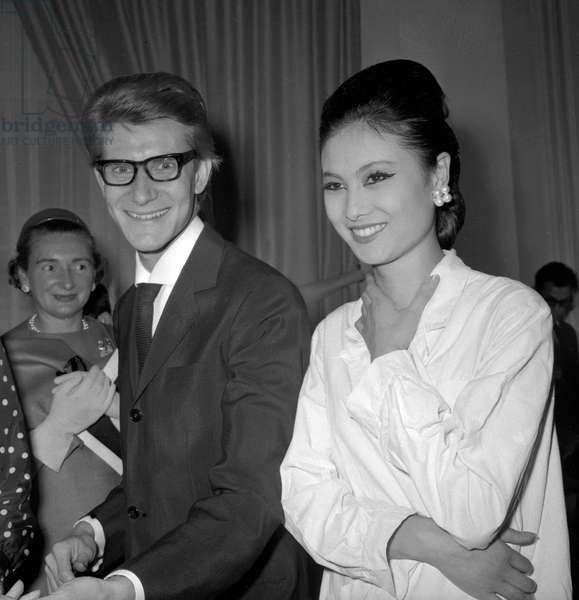 Yves Saint-Laurent and model Mieko, 1963 (b/w photo)