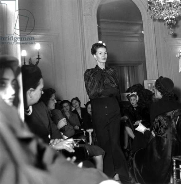 Model Lucie Daouphars, Called Lucky, during A Dior Fashion Show in February 1951 (b/w photo)